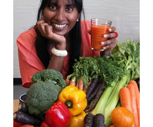 Dr Padayachee with orange carrot juice and other vegetables included in her research.