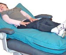 The Stay N Place Chair Liner curves in at the neck, allowing your patient's head to tilt back and the chest to be lifted, while leaving you room to maneuver.