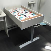 Child health clinic nurses benefit from height-adjustable table